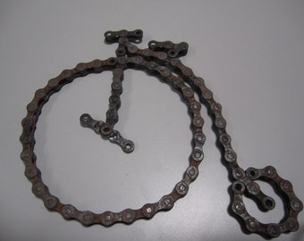 Bicycle made from recycled bike chain-antique type (Penny Farthing)