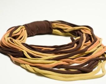 Necklace with yellow, orange and brown cotton stripes
