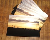 Set of 5 Winter Sunset Postcards. Silhouetted Church and village scene photographic Postcards.  Printed on semi- gloss card. A6 size. Blank.