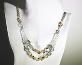 NYX NECKLACE. Swarovski Crystal Two Tier/ Two Strand Necklace Set in Sterling Silver. Clear, Silver and Golden Hues.