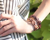 set of two braided leather bracelets