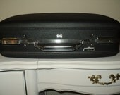 Vintage Plastic Suitcase made by The  AMERICAN TOURISTER LUGGAGE,  Grey Flannel Colored Plastic Exterior, with Red Plaid Interior