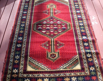Vintage Hand Knotted Kilim Mediterranean Style  Designed Area Rug with geometric and floral pattern with well worn look and frayed edges