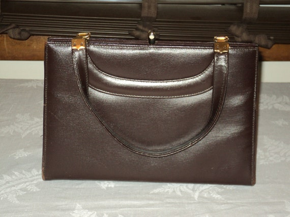 Vintage Classic Brown Leather Handbag with solid brass snap opening, brass feet on bottom in Near Mint Condition