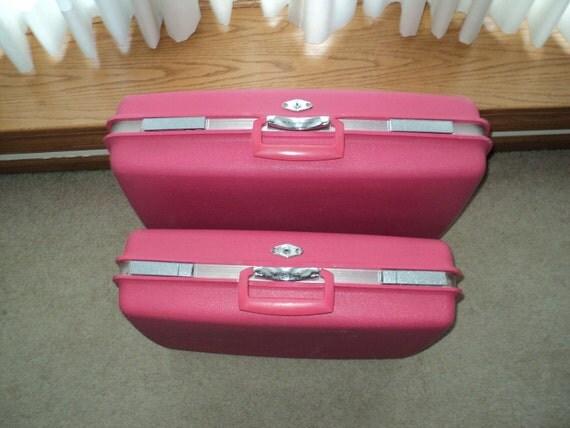 Pair of Hot Pink Plastic Suitcases