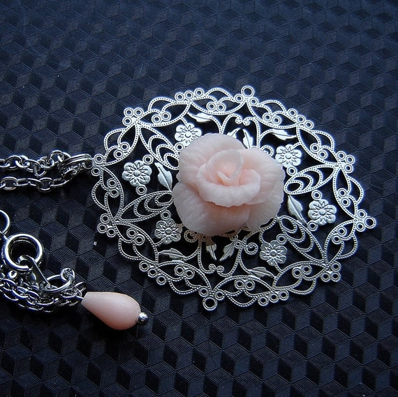 Gentle filigree pendant with pale pink rose.