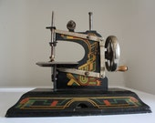 German made Casige vintage toy sewing machine Hold for nikinoo