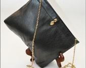 Small black leather clutch