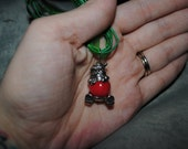 Green Ribbon Red Wood Bead Santa Necklace on Green Ribbon with Cross Back Detail