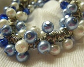 Blue and white glass pearl and blue bicones bracelet
