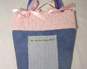 Pink fleece and denim purse
