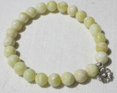 Stackable Bead Bracelet . Lemon Jade with Thai Hill Tribe Silver Flower Charm