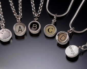 """Authentic old typewriter keys set in silver. Click """"Ask A Question"""" or """"Convo""""  Request your custom message on the back. Sold without chain"""