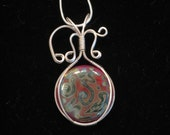 Handmade Silver wire wrapped red coin shaped lampwork cabochon