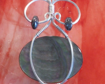 "Handmade Silver Wire Wrapped, Black Mother of Pearl Shell Pendant - ""Female Lust"""