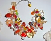 Beautiful orange and yellow perfume charm bracelet made with citrine, carnelian, swarovski crystal, shell beads, freshwater pearls