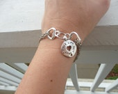Two Hearts Joined Charm Bracelet