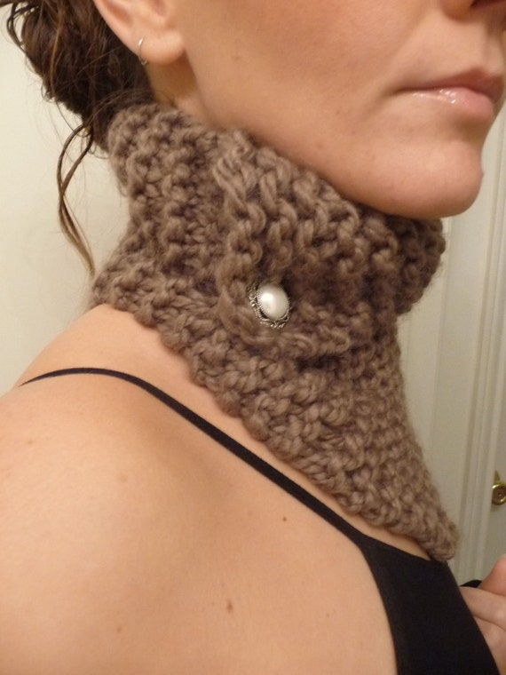 Tan colored neck warmer scarf with angled metro collar.
