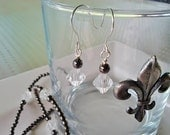 Dark gray beaded necklace with acrylic bycone beads, matching earrings