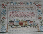 Clearing the Shop SALE-Village Green Sampler  Finished Cross Stitch-40% OFF