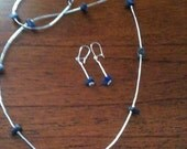 Lapis lazuli and liquid sterling silver necklace and earring set.
