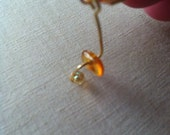 Abstract earrings with amber and yellow irridescent beads