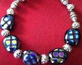 Lovely blue tone Czech beads with bali bead Accents bracelet
