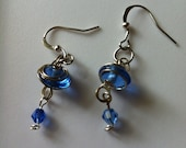 Blue glass beads with wire wrapping, and swarvoski beads