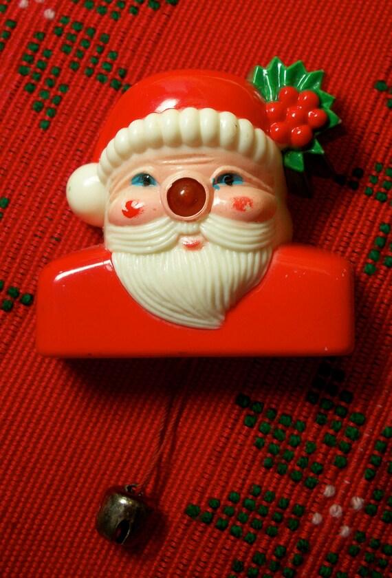 Santa brooch with light up nose vintage plastic