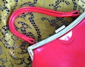 vintage 1960's red and gold handbag.