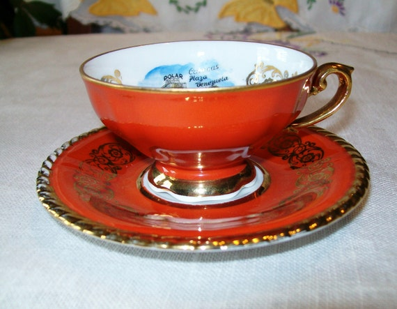 Vintage Souvenir  Demitasse Footed Cup and Saucer, Hand Painted Crimson, Gold and White, Caracas Venezuela Scene