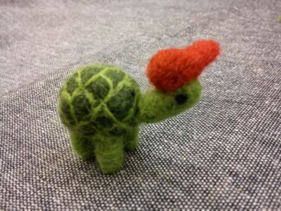Needle felted miniature turtle with a red cap