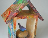Colorful batik fabric birdhouse with handmade clay bird and nest egg