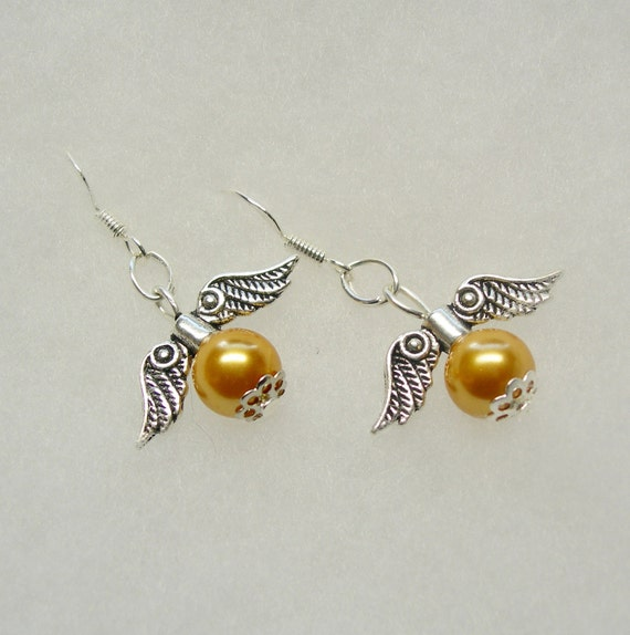 golden snitch earrings harry potter golden snitch earrings designed 4144