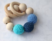 Teething toy with crochet navy blue, cyan/aqua, light pale blue wooden beads and 2 wooden rings. Wooden rattle. Teething ring