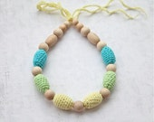 Teething necklace in aqua blue/ turquoise, light yellow and light green. Crochet wooden beads nursing necklace for her.