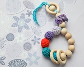 Teething toy rattle with crochet wooden beads and 3 wooden rings. Lilac, teal, lavender, red.