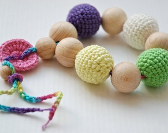 Teething toy with crochet wooden beads. Yellow, green, lilac, white, pink.