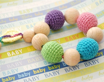 Teething toy with crochet wooden beads. Yellow, blue, pink, green, violet.