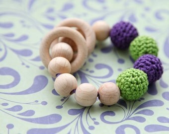 Lilac/ purple and neon green teething ring toy with crochet wooden beads. Rattle for baby.