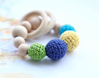 Teething toy with crochet wooden beads. Yellow, neon green, blue/ cyan/ turquoise, dark blue.