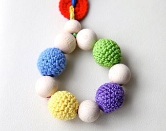 Teething toy with crochet wooden beads. Yellow, blue, red, green, violet.