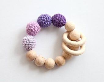 Lavender, lilac, violet teething ring toy with crochet wooden beads. Rattle for baby.