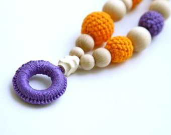 Amber orange and violet nursing necklace with wooden ring. Mammy and baby teething ring necklace. Girls crochet necklace.