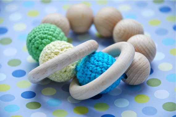 Teething toy with crochet wooden beads and 2 wooden rings. Green, yellow, blue wooden beads rattle.