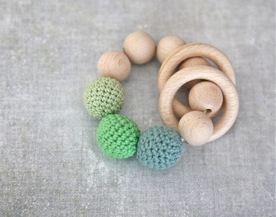 Teething toy with crochet green wooden beads and 2 wooden rings. Wooden rattle. Teething ring