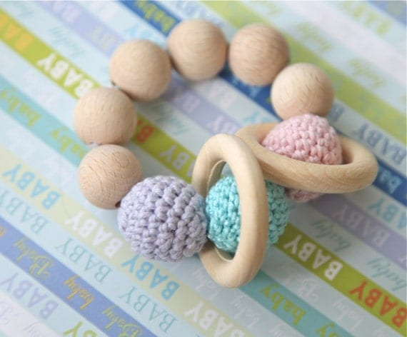 Teething toy with crochet pale pink, lavender blue, blue/ magic mint  wooden beads and 2 wooden rings. Wooden rattle. Gift for baby and mum.