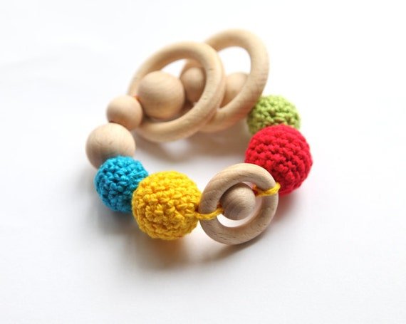 Teething rings toy rattle with crochet wooden beads and 3 wooden rings. Blue, green, yellow, red