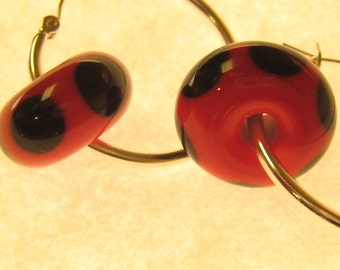 handmade lampwork glass earrings featuring unique red and black beads