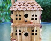 """Birdhouse """"Two Story with Porch """", wood and wine corks."""
